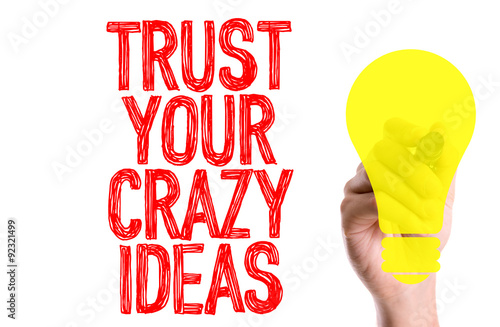 Poster Hand with marker writing: Trust Your Crazy Ideas