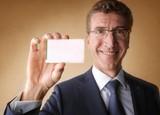 Smiling businessman holding a cardboard