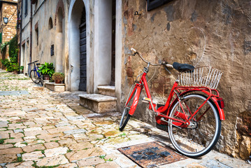 Abandoned bike on the Italian street in the old Tuscany
