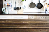 Fototapety Empty brown wooden table and blurred kitchen background, product display