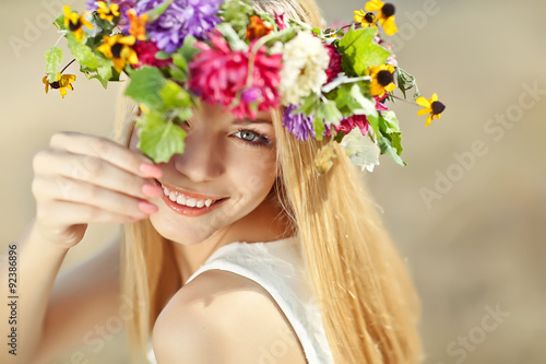 Poster beautiful woman in flowers