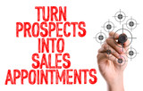 Hand with marker writing: Turn Prospects Into Sales Appointments