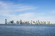 City skyline of Jersey City and Hoboken New Jersey from across the waters of the Hudson River