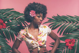 Sensual Afro American Pin-up Between Palm Leaves. Against Pink B