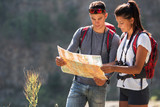 Fototapety Couple hiking. Using map to get good direction