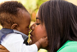African American mother holding her son.