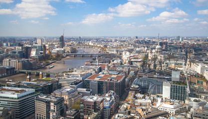 LONDON, UK - SEPTEMBER 17, 2015: City of London aerial view, Westminster side of city and bridges. London panorama form 32 floor of Walkie-Talkie building