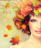 Fototapety Autumn Beauty - woman fashion Makeup With Red and yellow autumn Leaves. Autumn wreath on girl head . Emotions and surprise on the face of the autumn girl .