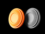 Closeup of two clay pigeon targets isolated on a black background. Clipping path inctuded.