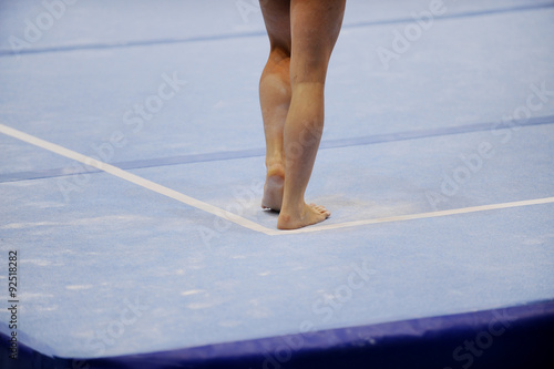Feet on gymnastics floor Poster