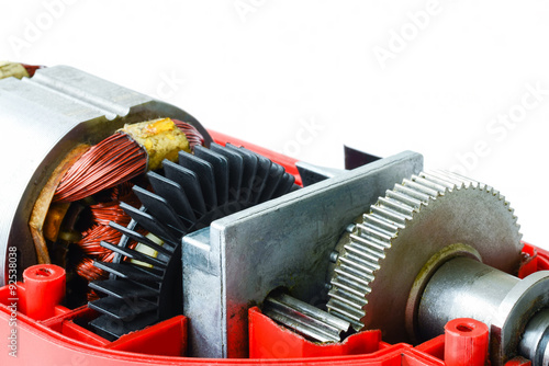 Disassembled electric drill isolated on white background showing motor, gears an Poster