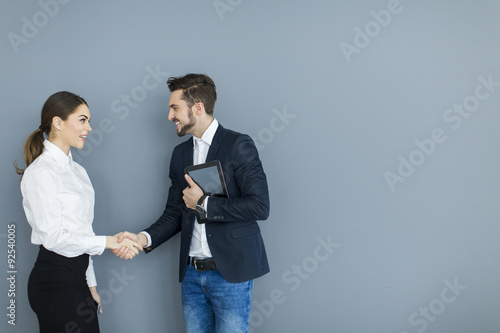 Young couple working in the office Poster