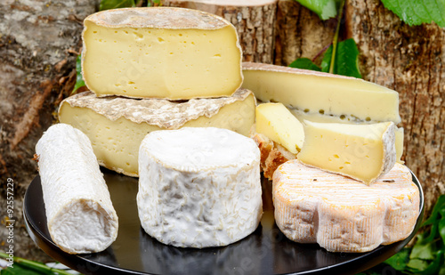 Naklejka tray with different French cheeses