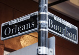 Fototapety Street signs for Rue D' Orleans and Rue Bourbon in New Orleans, Louisiana