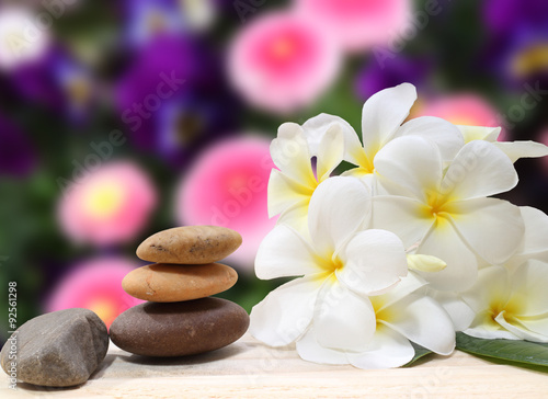 Zen spa concept background - Zen massage stones with frangipani plumeria flower Poster