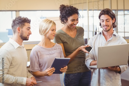 Business team using laptop in office