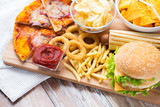 Fototapety close up of fast food snacks on wooden table