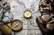Old compass, astrolabe on vintage map. Retro style.