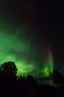 Red aurora streak over Kachemak bay Alaska