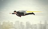 Fototapety Superhero business man flying with jet pack rocket above the cit
