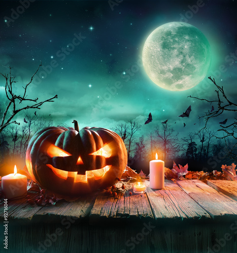 Poster Halloween Pumpkin On Wooden Plank With Candles In A Spooky Night
