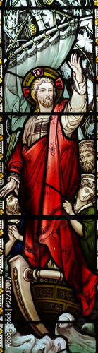 Naklejka Jesus Christ calming the storm in stained glass