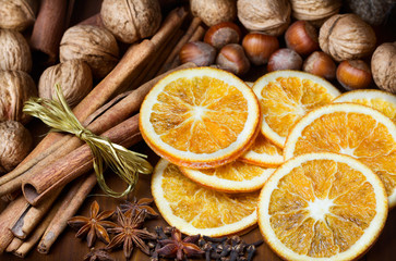 cinnamon sticks, cloves, anise stars,walnuts and slices of dried citrus