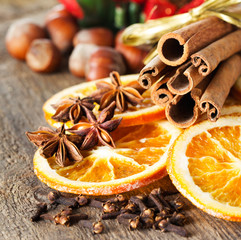 cinnamon sticks, cloves, anise stars and slices of dried citrus