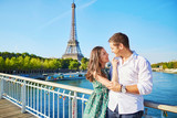 Young romantic couple having a date near the Eiffel tower - 92751659