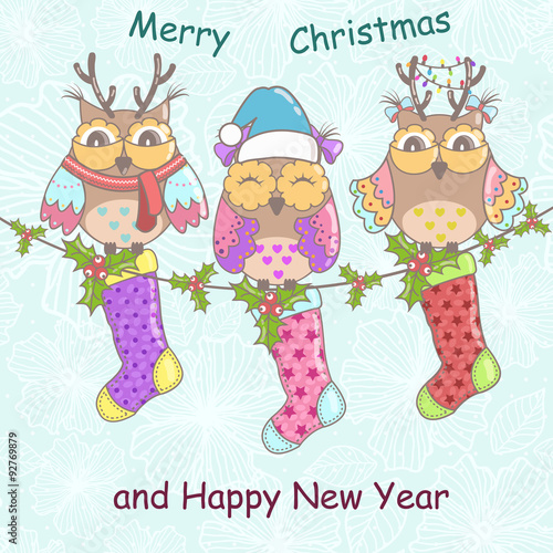 Papiers peints Hibou Christmas card with owls and Christmas socks on a blue background