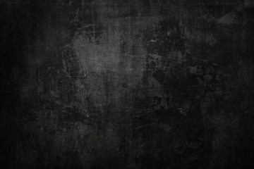 Textured black grunge background © enjoynz