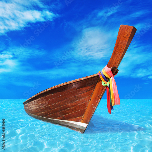 Poster  wooden boat in the blue sea