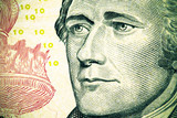 Close up to Alexander Hamilton portrait on ten dollar bill. Tone