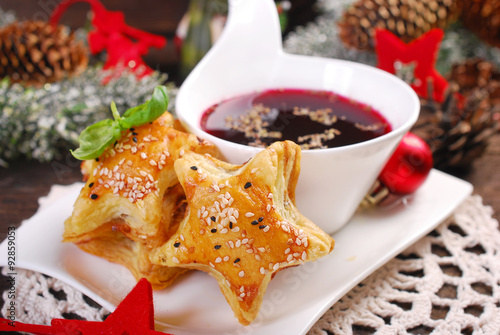 Naklejka puff pastries and red borscht for christmas eve
