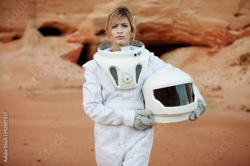 futuristic astronaut without a helmet on another planet, image