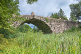 Hundred-meter boulder-arch bridge with two grotto - aviary poster