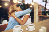 Fototapety Two affectionate girl friends embracing