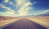 Fototapety Vintage style country highway in USA, travel adventure concept.