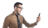 Furious young businessman on mobile phone