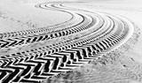 tire tracks prints in beach sand - 93109462