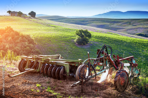 Tuscany landscape at sunrise. Retro agriculture machines. Italy Plakat