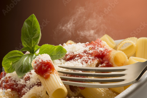 dish with macaroni and tomato sauce