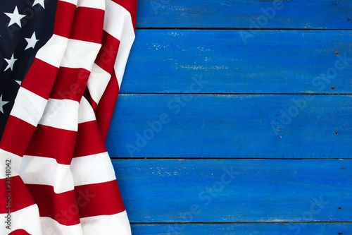 American flag on rustic royal blue wood background
