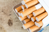 Cigarettes sticking out from the pack - 93193687