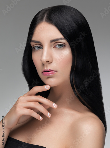 obraz lub plakat Beautiful portrait closeup of a young woman with black hair and nude makeup.