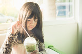 Beautiful asian girl drinking iced greentea poster