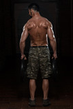 Athlete Doing Heavy Weight Exercise For Trapezius poster