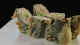 Sushi rolls / Japanese cuisine. White dressing black background