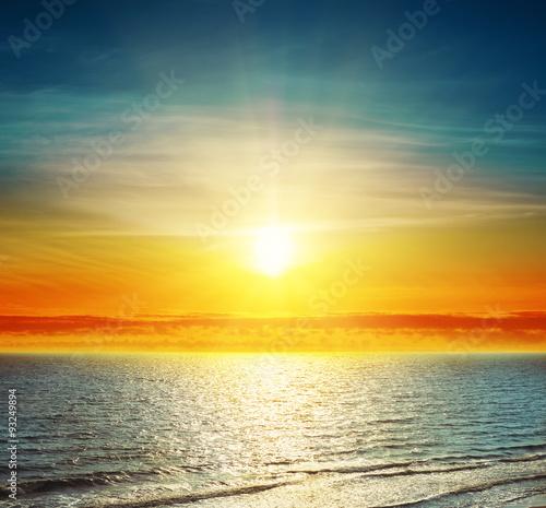Panel Szklany good sunset over darken sea