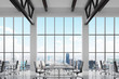 Modern workplaces in a modern bright clean interior of a loft style office. Huge windows with New York panoramic view. White desks equipped with laptops, black leather chairs. 3D rendering.